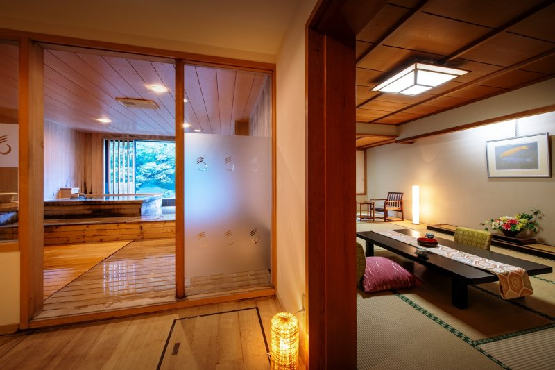 A guest room with a private open-air hot spring bath.